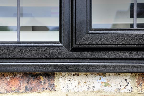 Close up showing the realistic black woodgrain effect